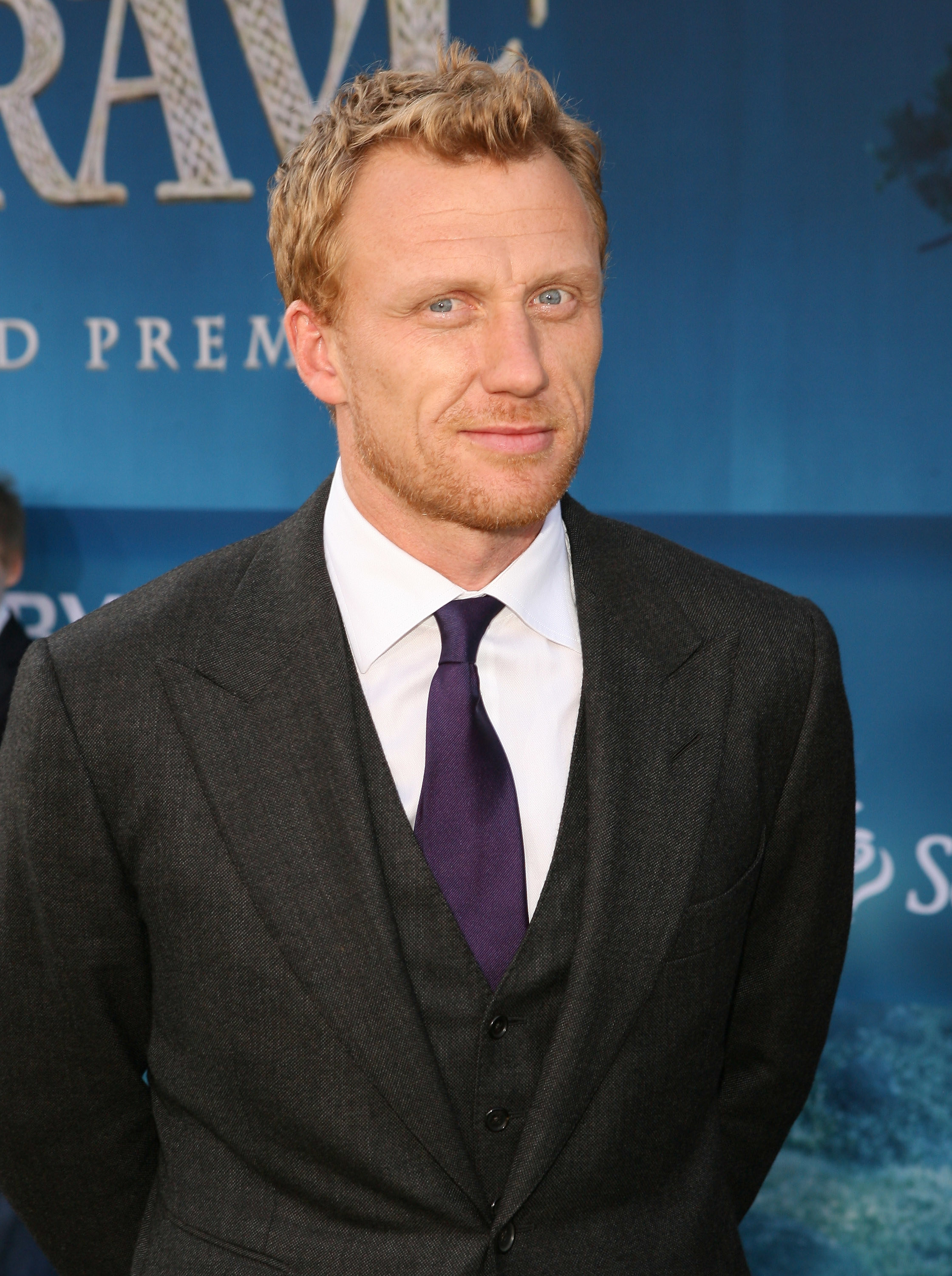 Kevin McKidd poses in a suit