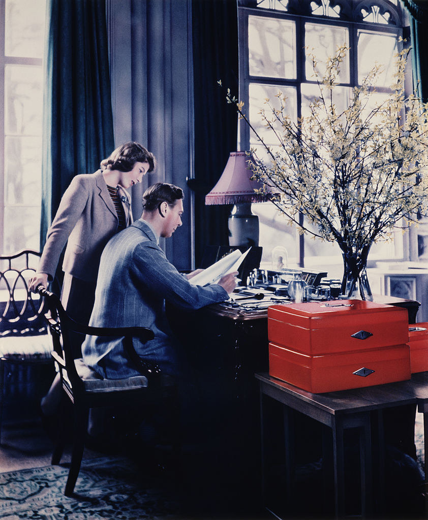 Princess Elizabeth and King George VI looking over papers in the King's study
