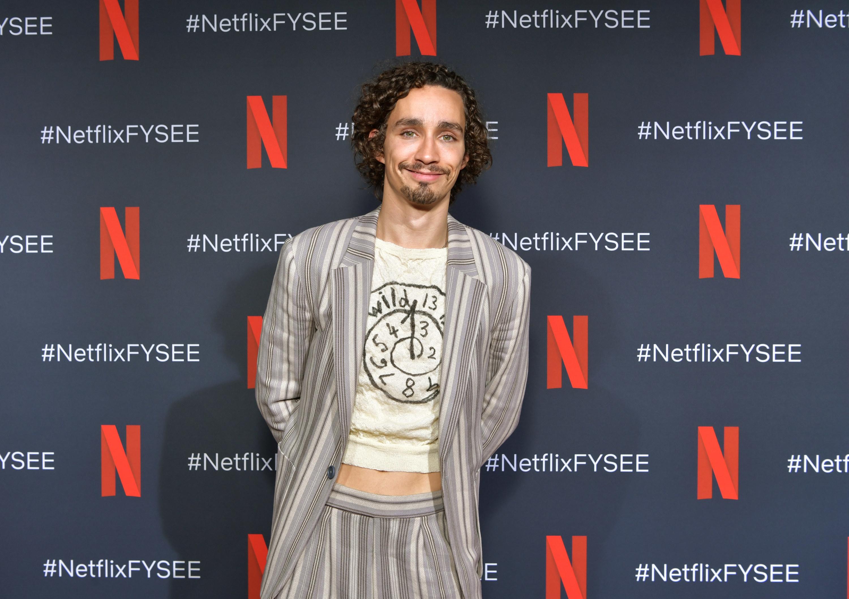 Robert Sheehan poses at a Netflix event