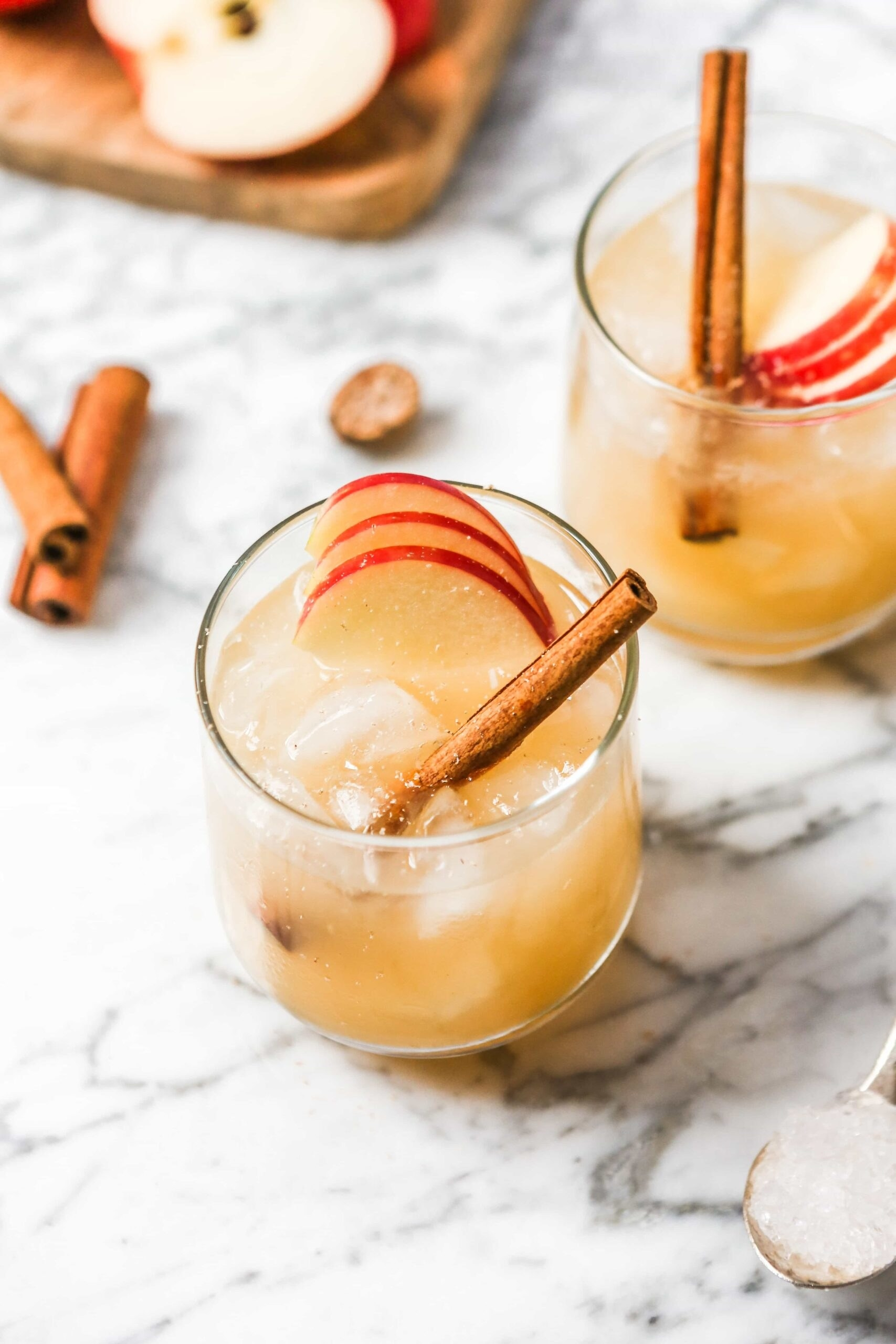 Apple bourbon smash with a cinnamon stick in a glass