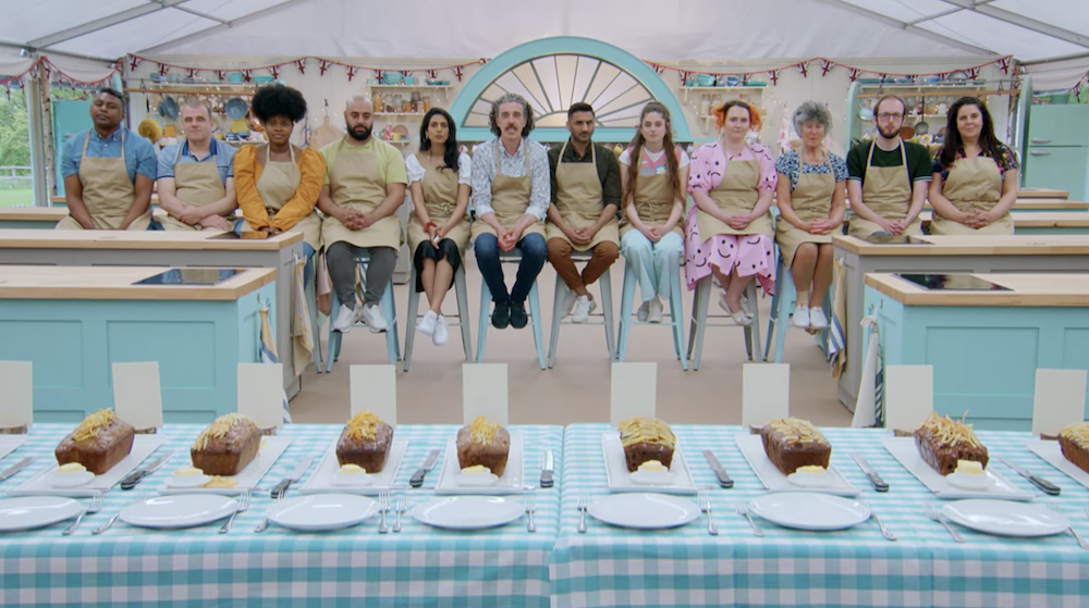 The contestants sitting behind their technical challenge bakes