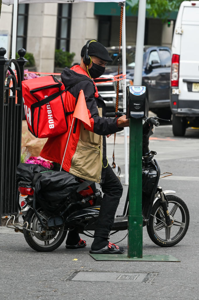 A grubhub delivery person on a scooter
