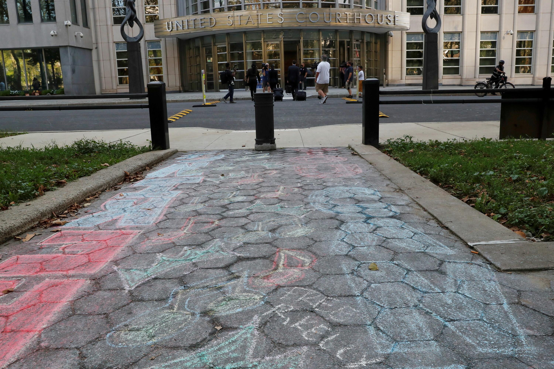 """""""Free R Kelly"""" is written in chalk on a sidewalk"""