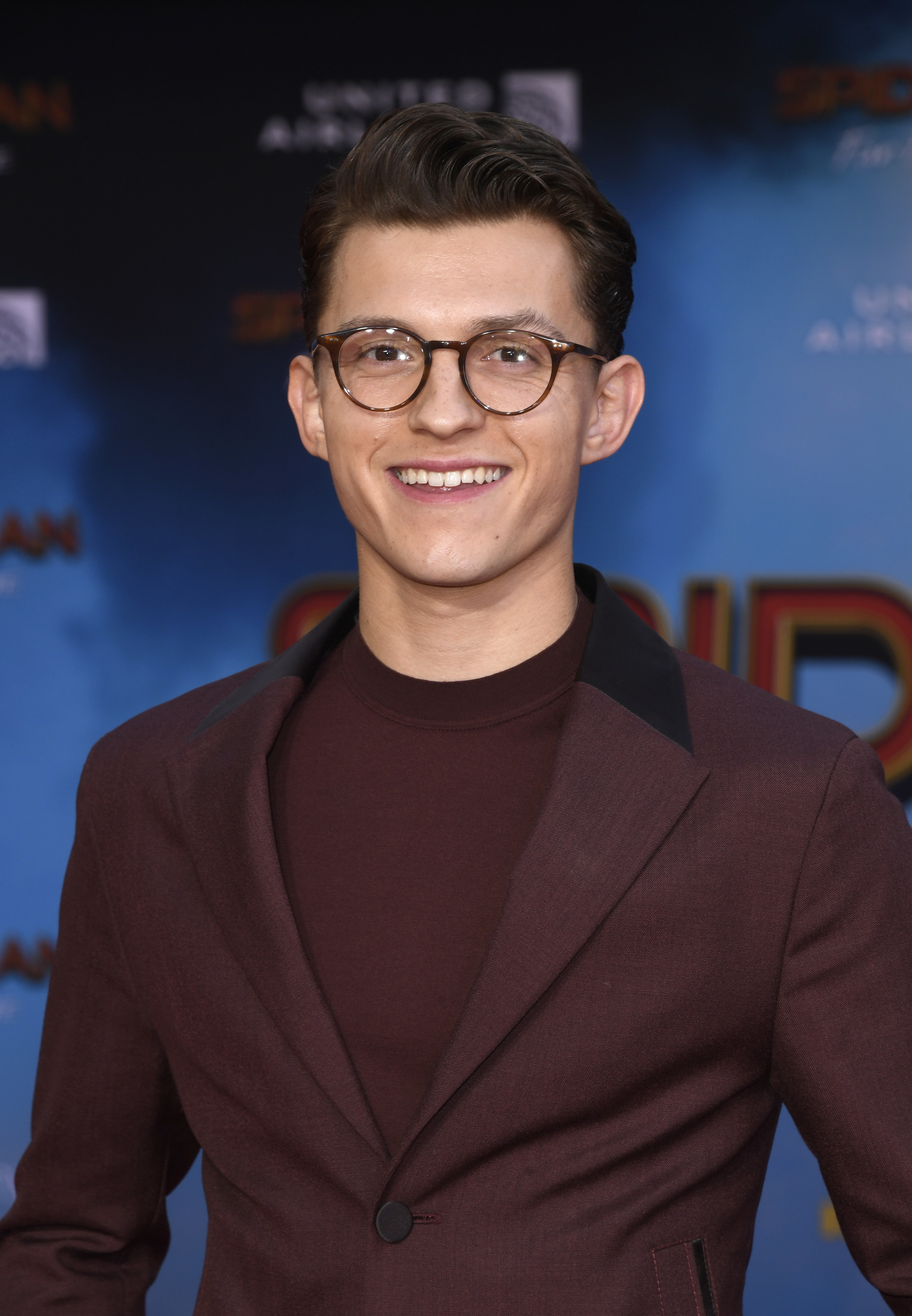 Tom Holland in a maroon suit