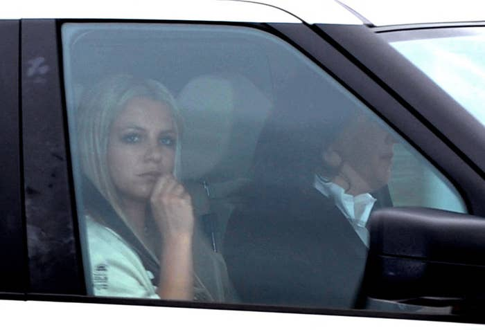 Britney looking out the window as she sits in the front passenger's seat