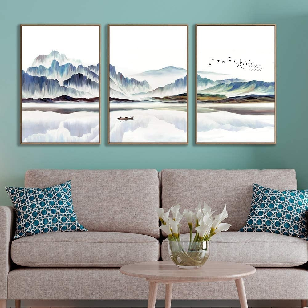 Three paintings above a couch