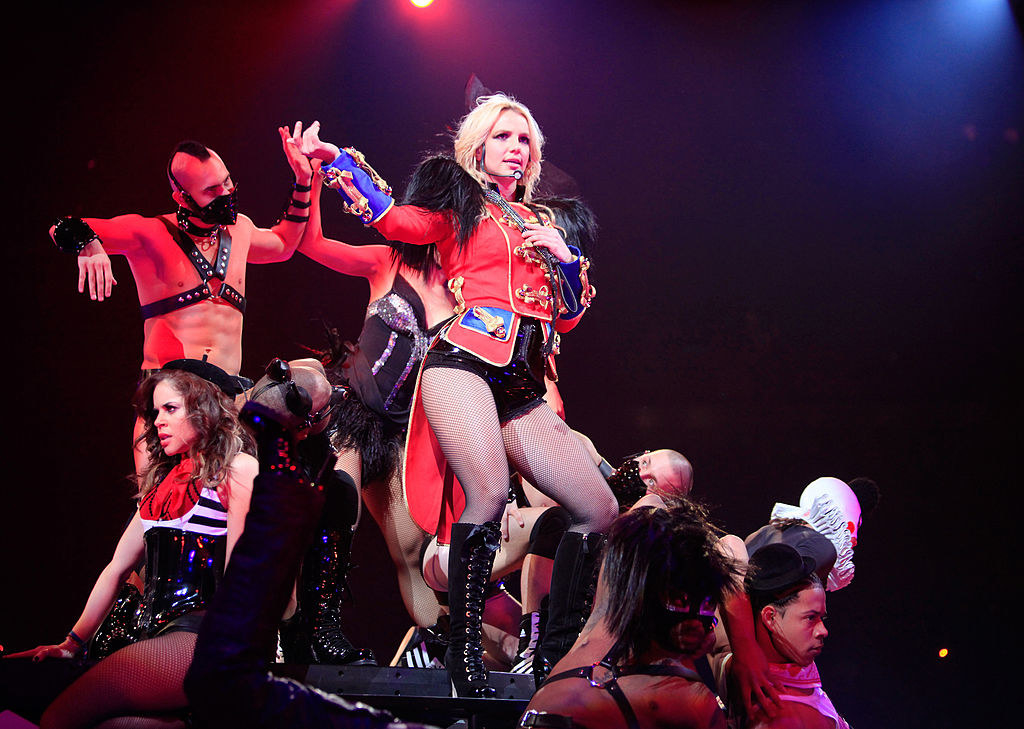 Britney surrounded by backup dancers on stage