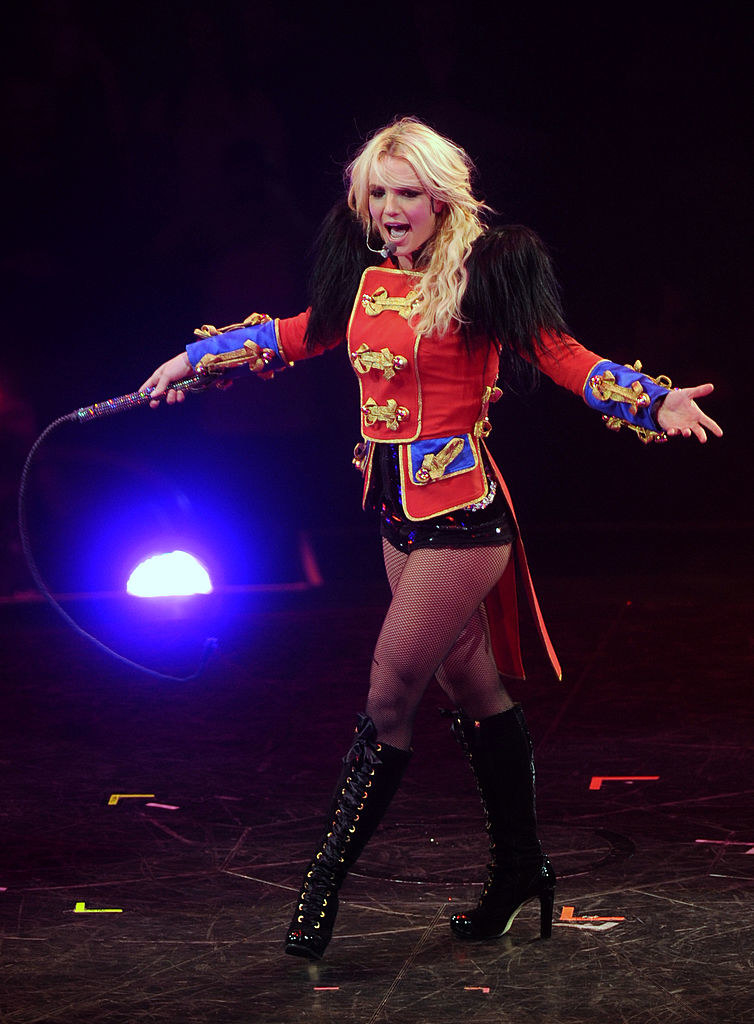 Britney performing in a ringmaster-inspired top and shorts with matching boots