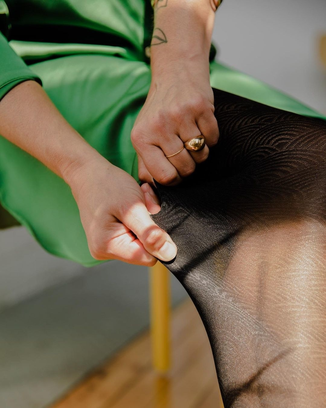 A person pulling at the leggings