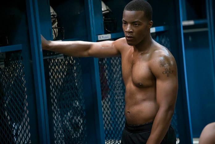 Daniel Ezra as Spencer in lockerroom scene