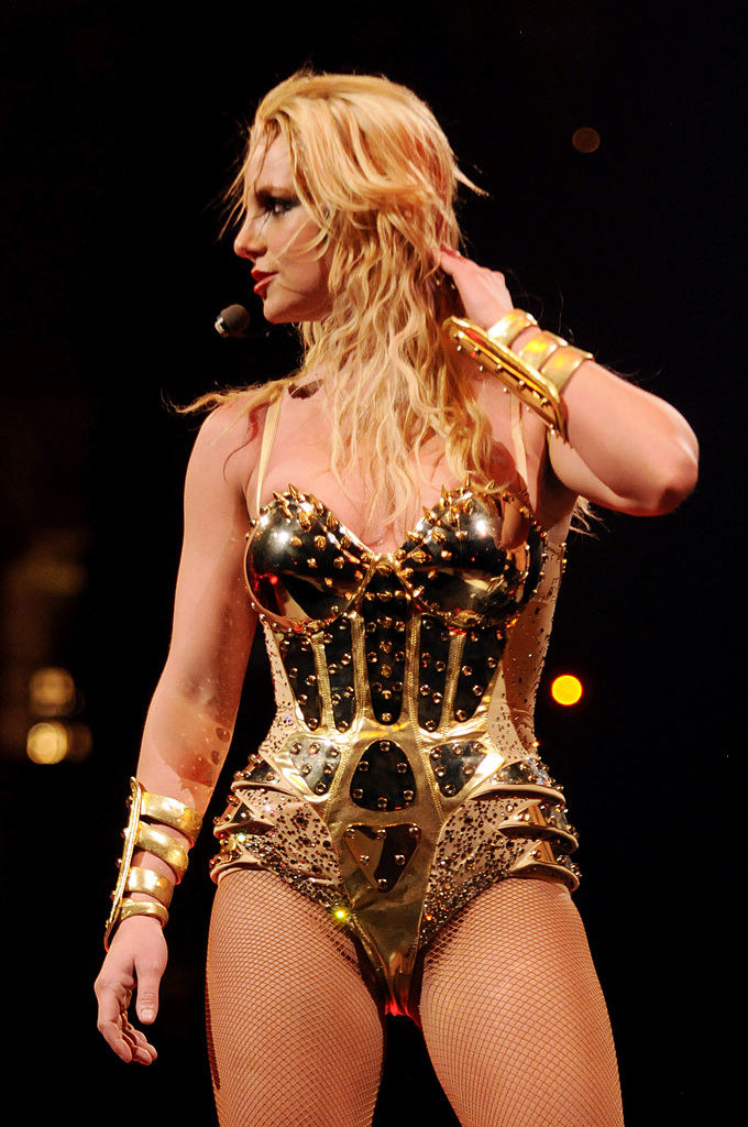 Britney performing on stage in a metallic leotard