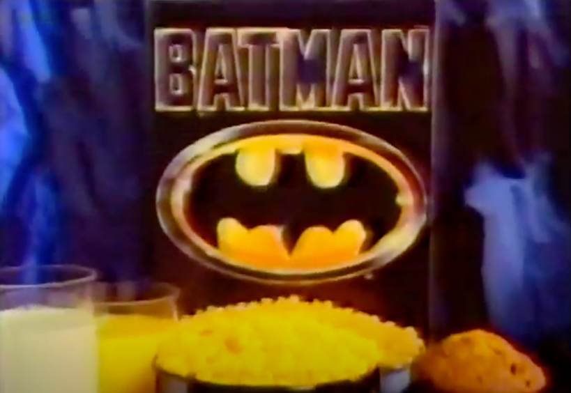 A screenshot of the Batman cereal box with a bowl of it, and a muffin