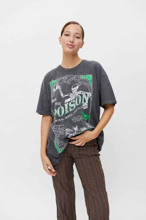 a model wearing the poison skeleton tee