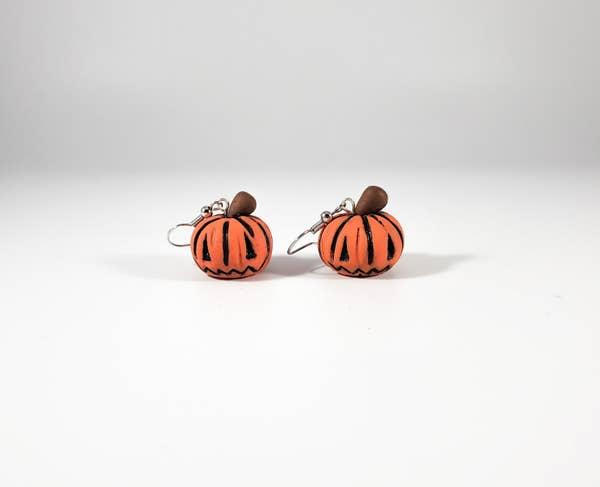 a pair of jack-o-lantern earrings