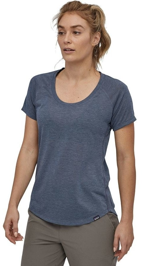 model in navy blue lightweight tee and charcoal active pants
