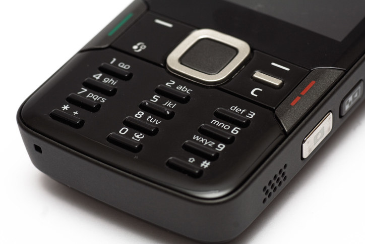 keypad of a black candy bar style mobile phone