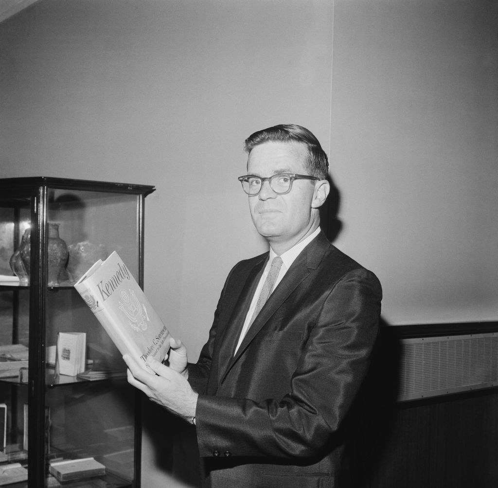 Ted Sorenson holds a book he wrote about Kennedy