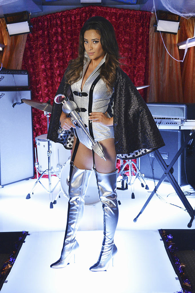 Emily dressed like a sexy space alien with metallic silver boots for Halloween