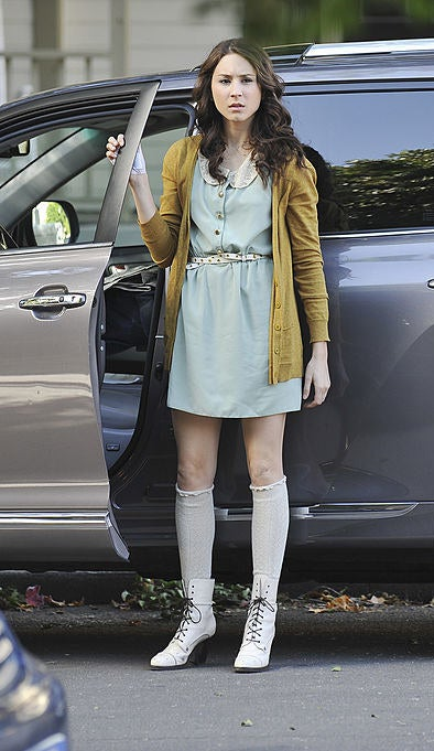 Spencer wearing socks and laced, heeled boots and a dress