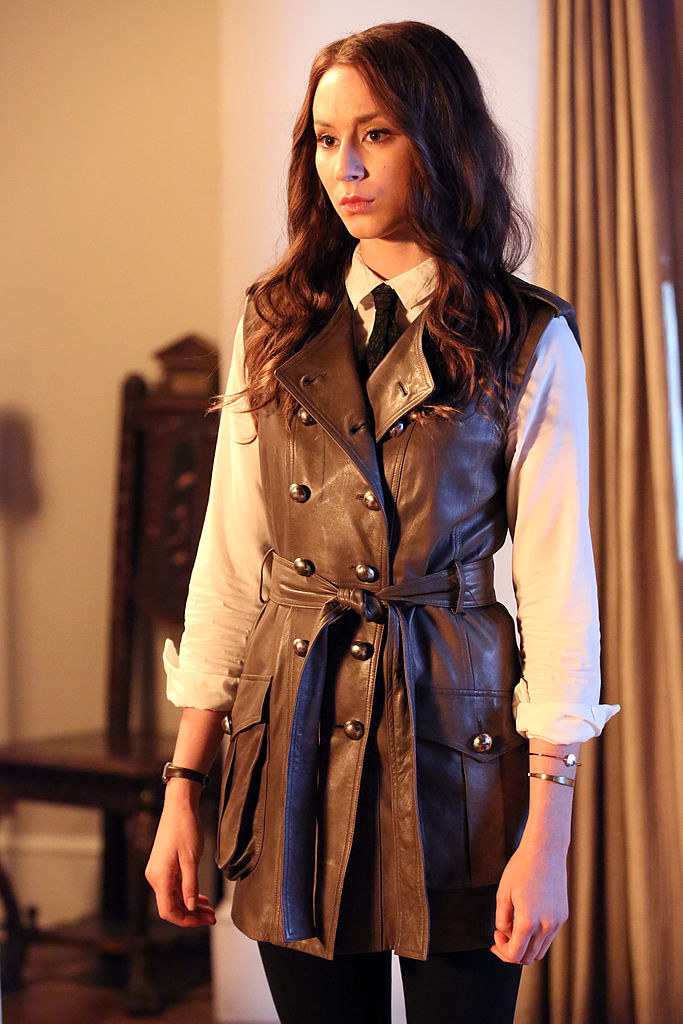 Spencer wearing a brown trenchcoat with a tie