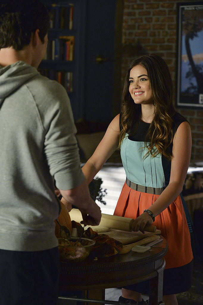 Aria wearing a neon-colored dress