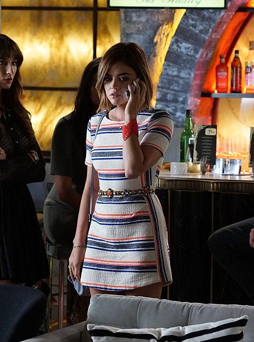 Aria wearing a striped body con dress
