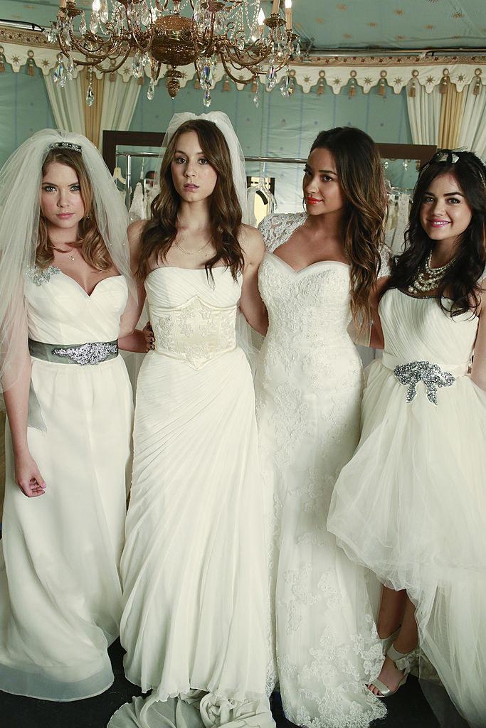 all four girls wearing custom wedding dresses