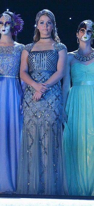 Ali wearing a long, beaded blue gown