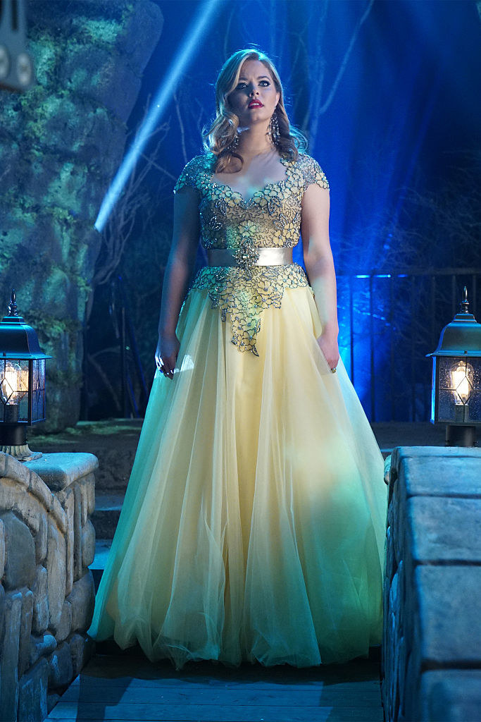 Ali wearing a yellow ball gown