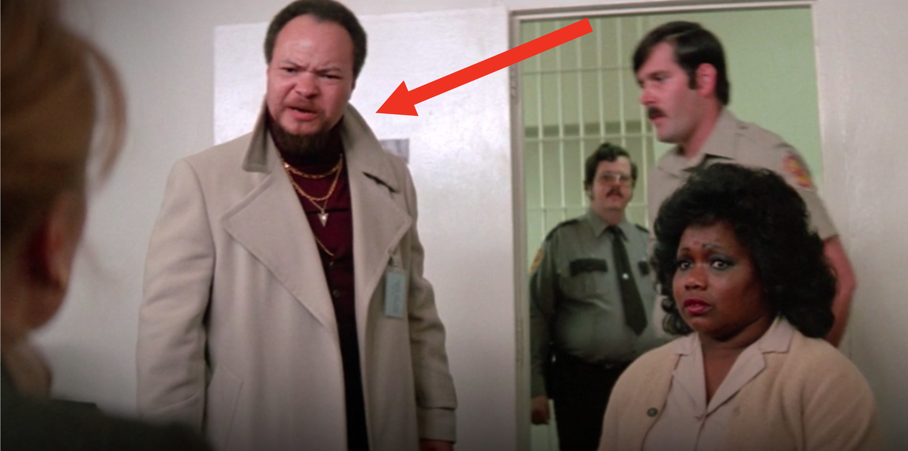 """Stephen stands next to his on-screen wife in """"Marie: A True Story,"""" in the background are two cops and seen slightly out-of-frame to the left is the back of Sissy's head"""