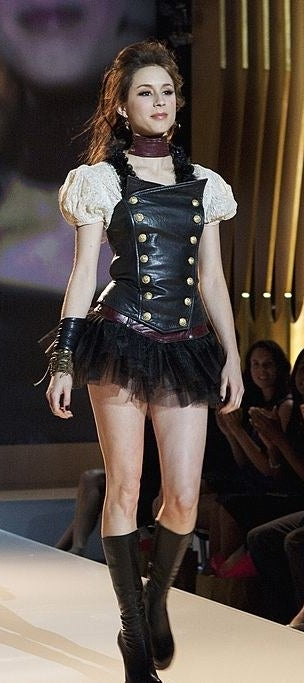 Spencer wearing a sexy pirate costume in a fashion show