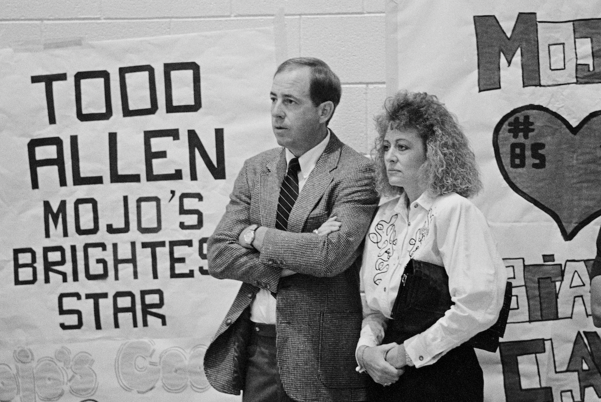 """A man and a woman stand next to lettering: """"Todd Allen Mojo's Brightest Star"""""""