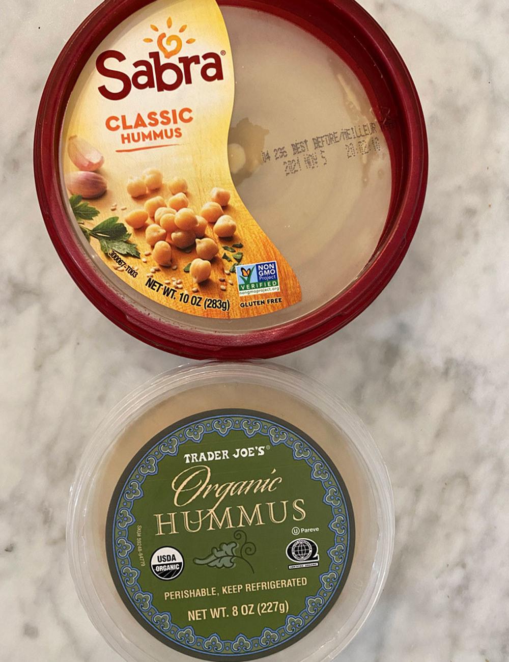 Sabra hummus and Trader Joe's hummus in the packaging