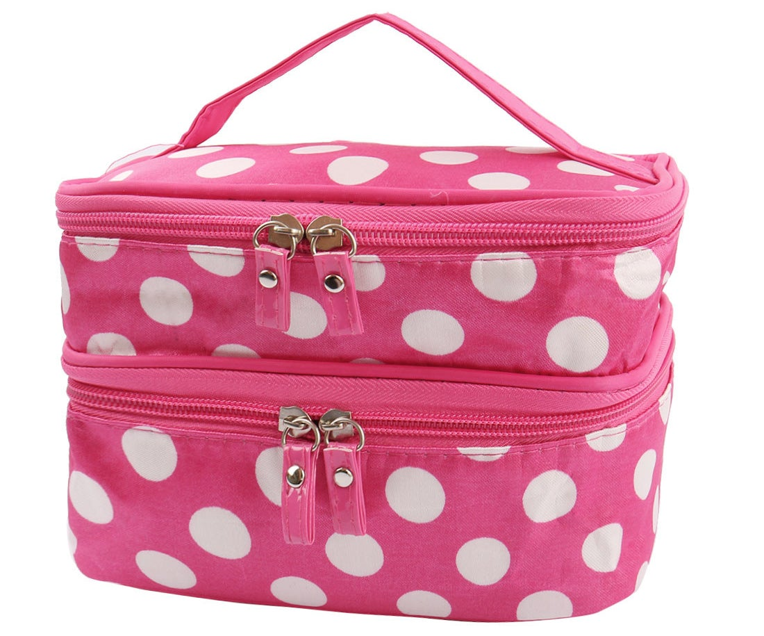 The fuchsiapolka-dot patterned toiletry case