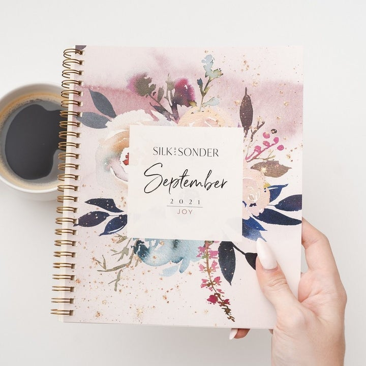 The floral-print cover of a September planner