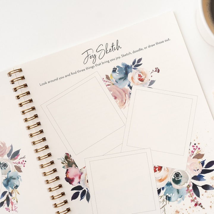 an inside page filled with blank polaroid frames to sketch inside things that bring you joy