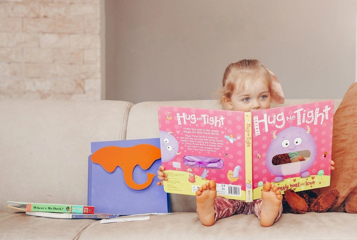 a child reading books from their subscription box
