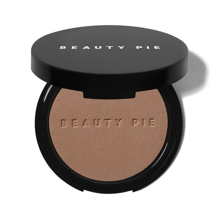 A Beauty Pie Quantum Bronzer Matte compact with logo
