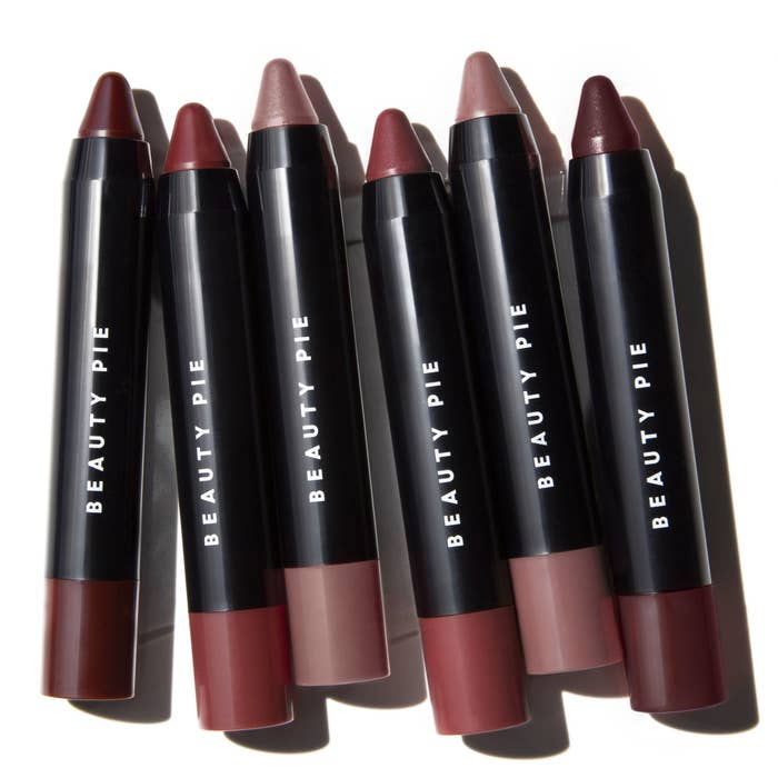 Shine Up™ Lip Colour Balm Sticks in different shades with logo