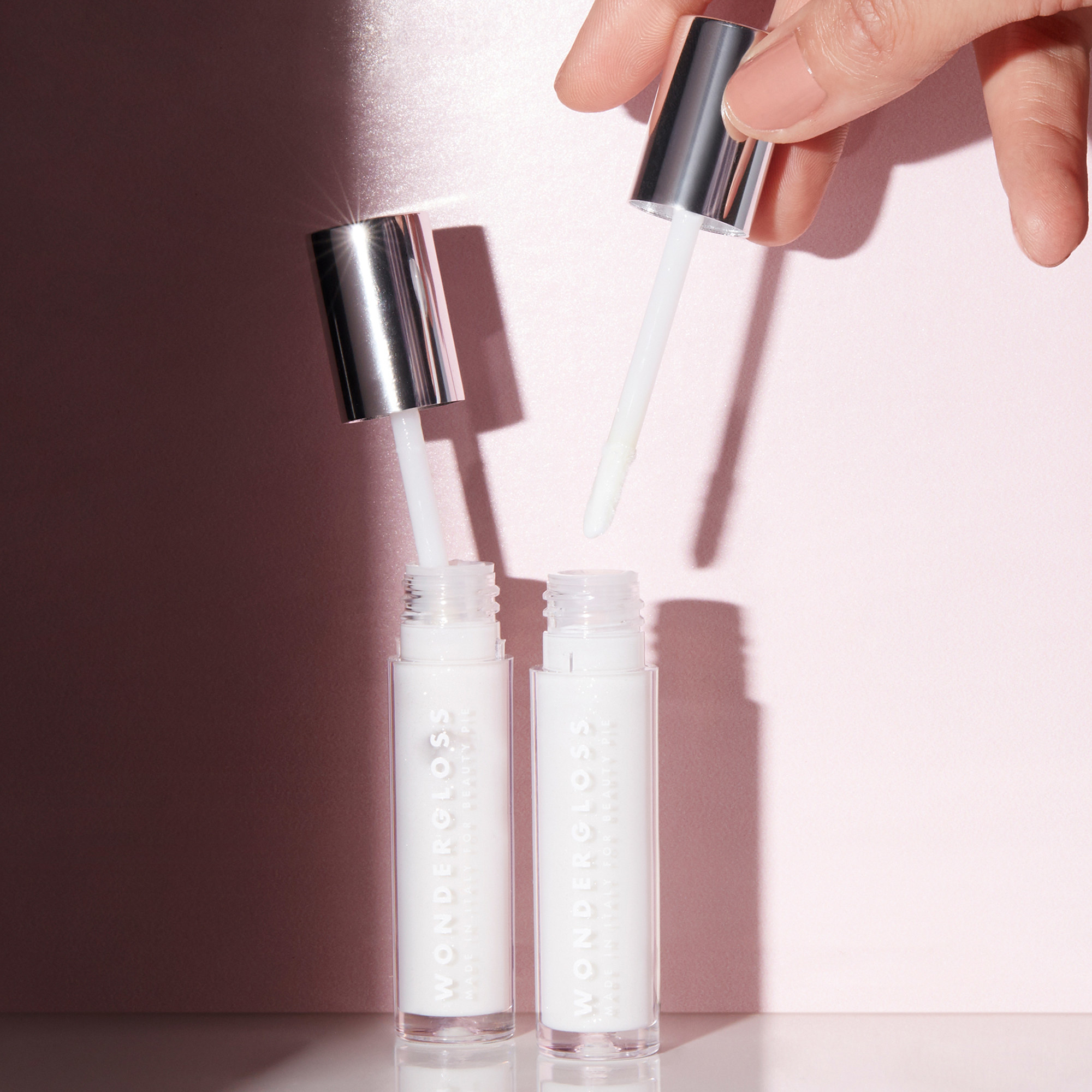 Two containers of Wondergloss Collagen Lip Oil +
