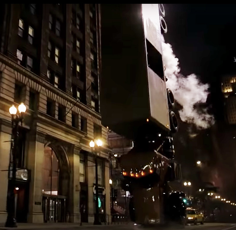 the Joker's semi flips over in the middle of downtown Chicago