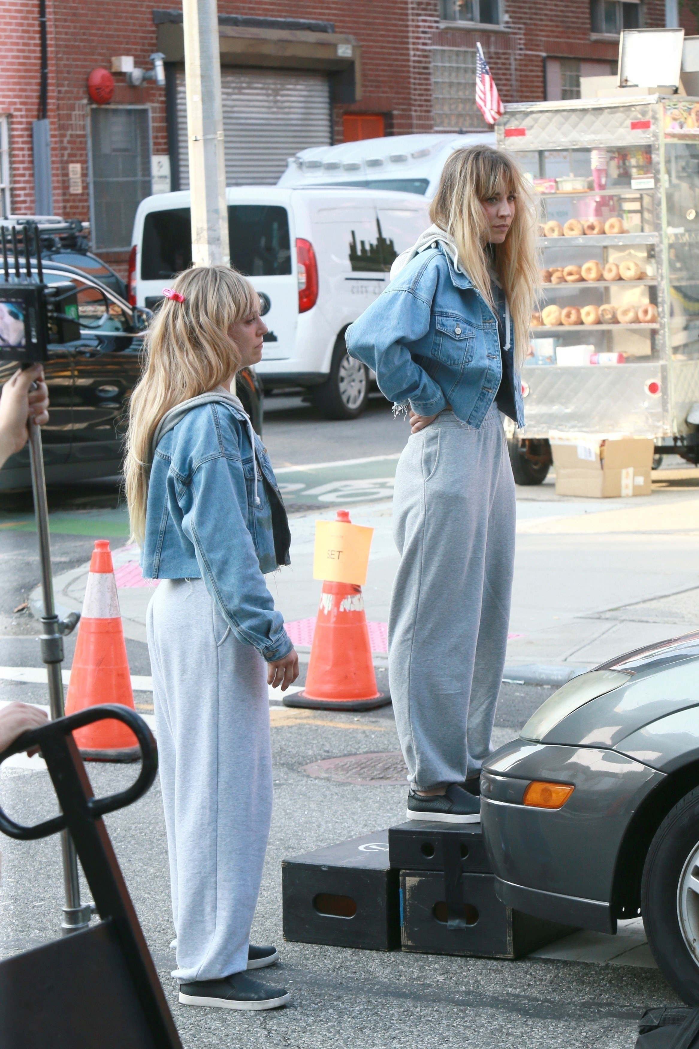 Kaley Cuoco and her stunt double filming outdoors