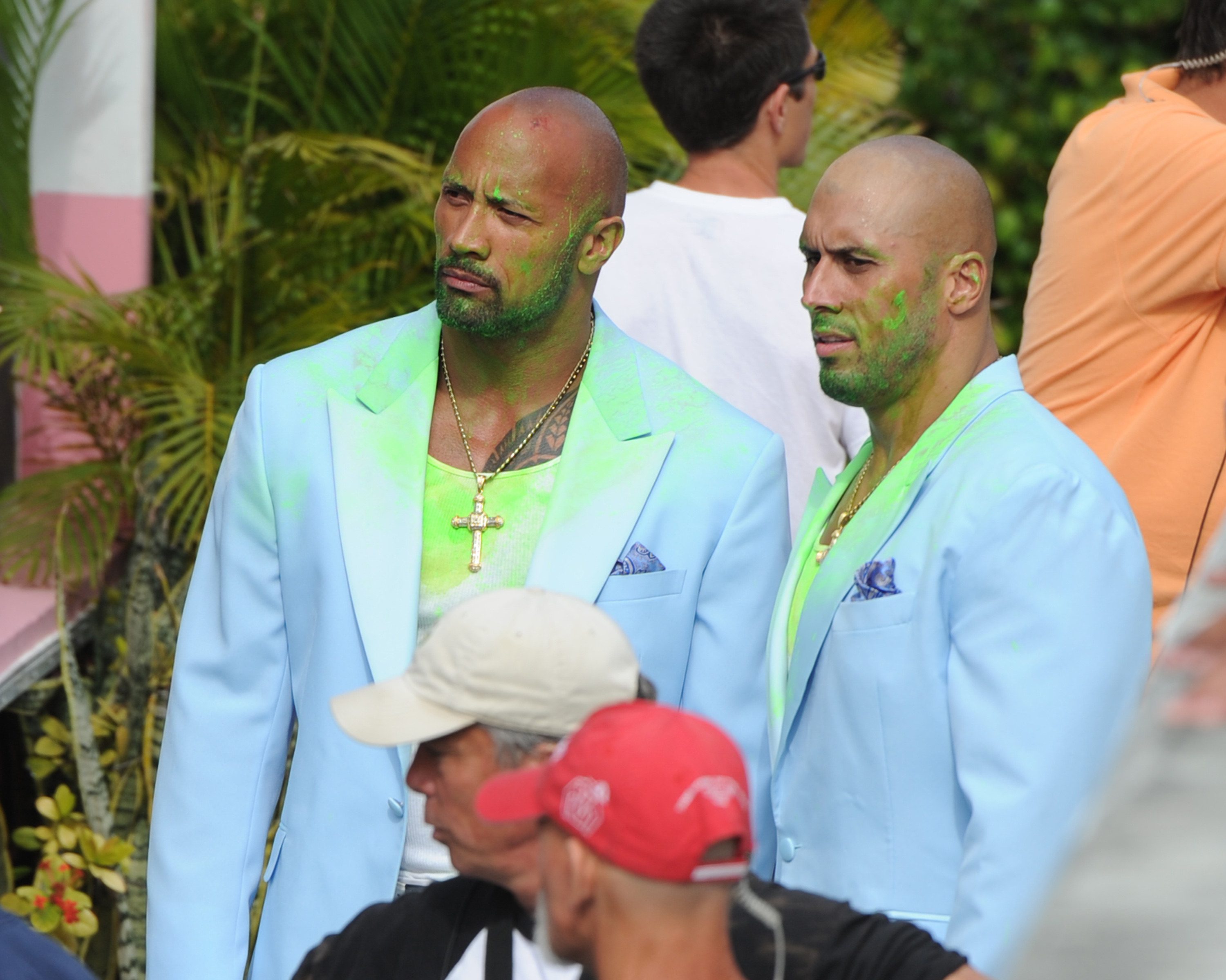 the rock and his stunt double wearing light blue blazers while filming
