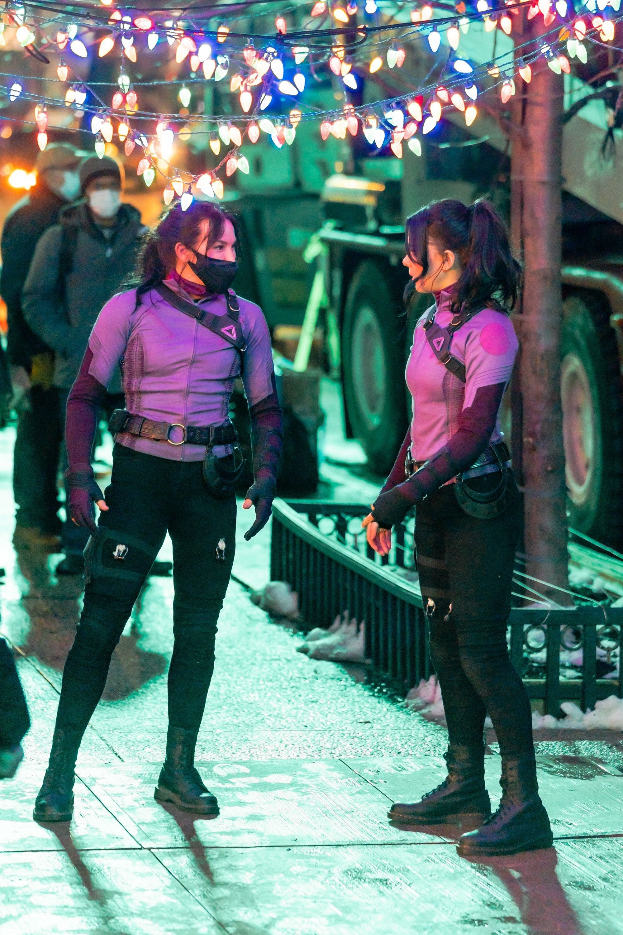 Hailee Steinfeld and her stunt double filming at night outdoors