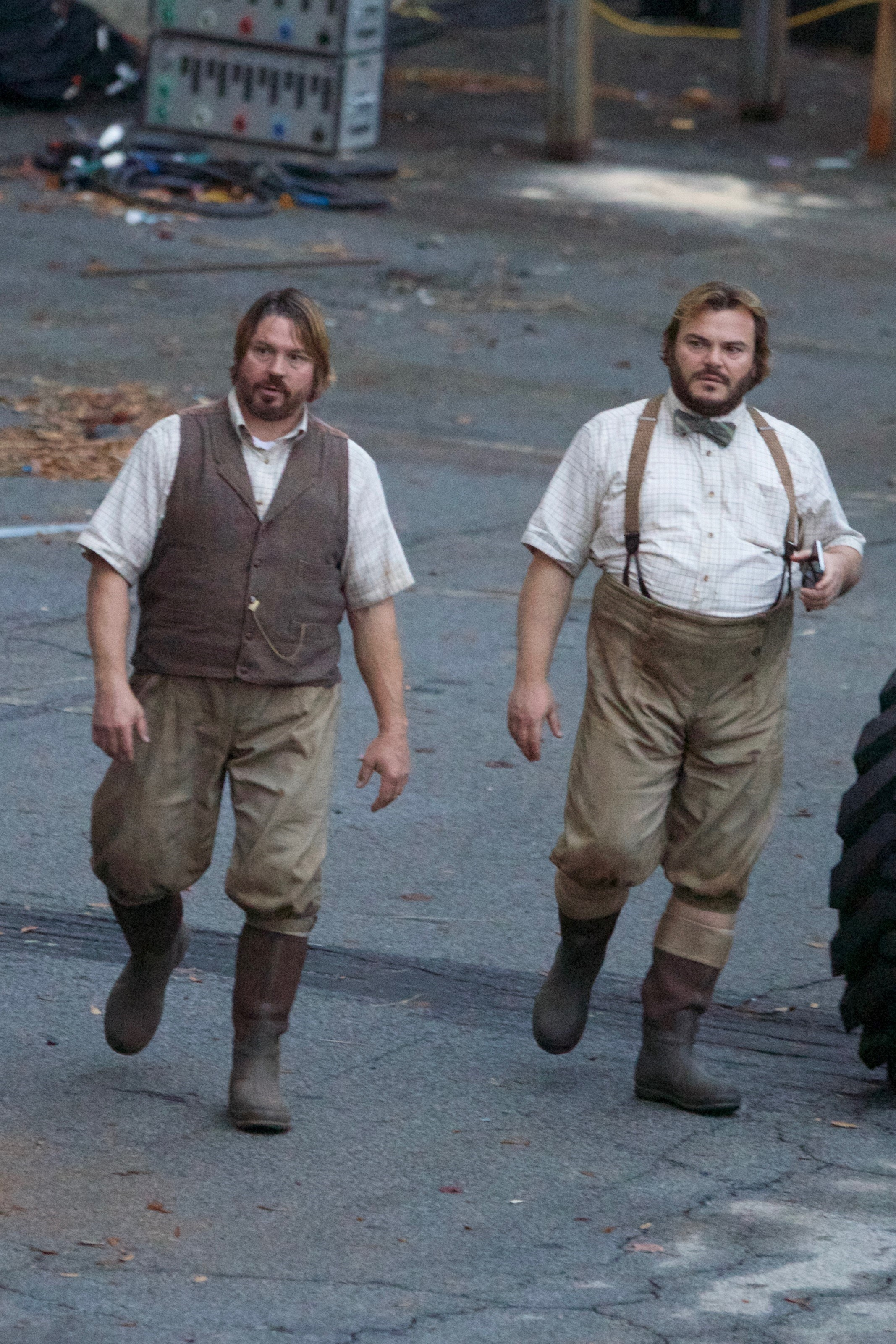 Jack Black and hus stunt double walking while filming
