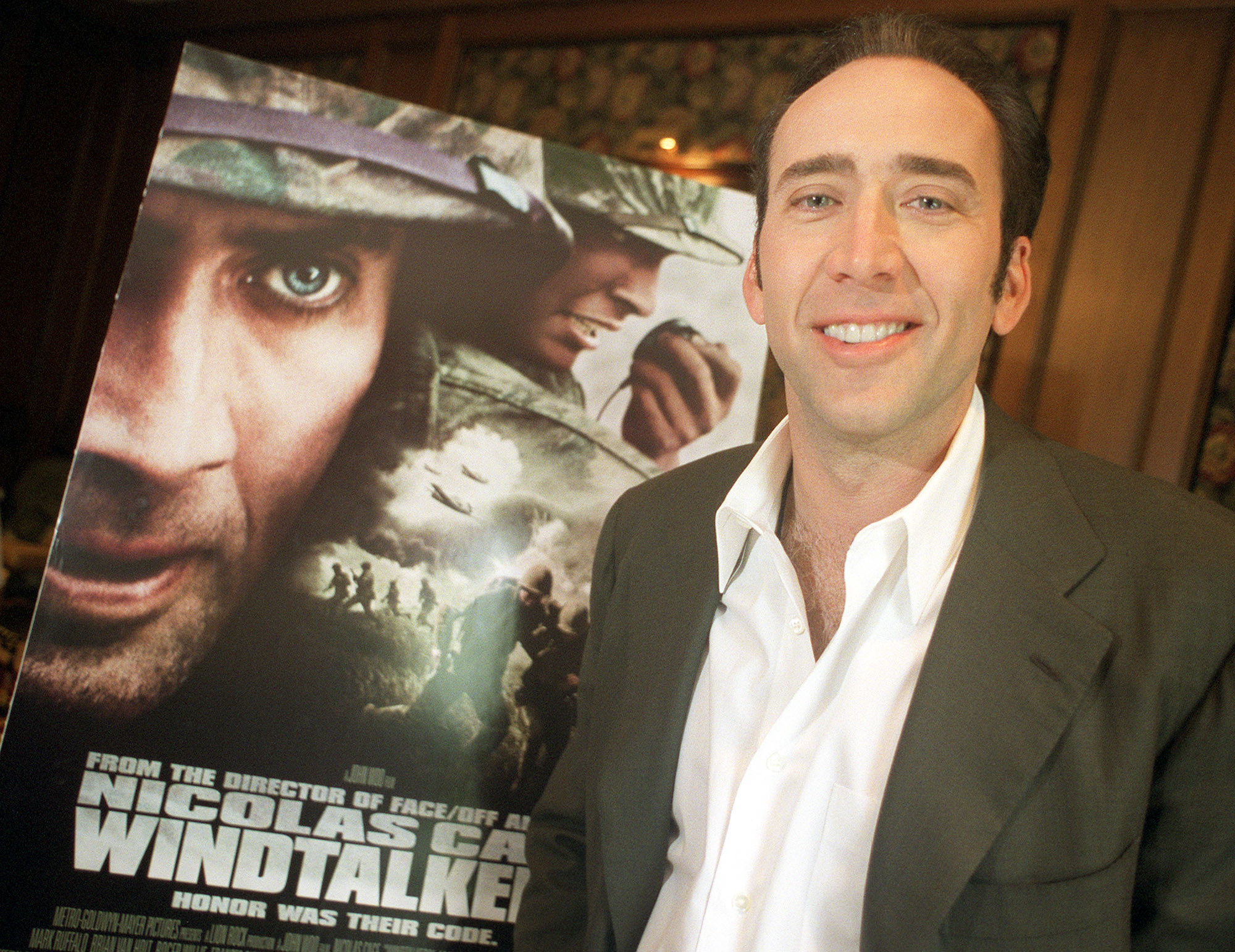Nicolas Cage next to his own poster