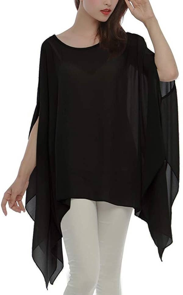 a model wearing the black tunic