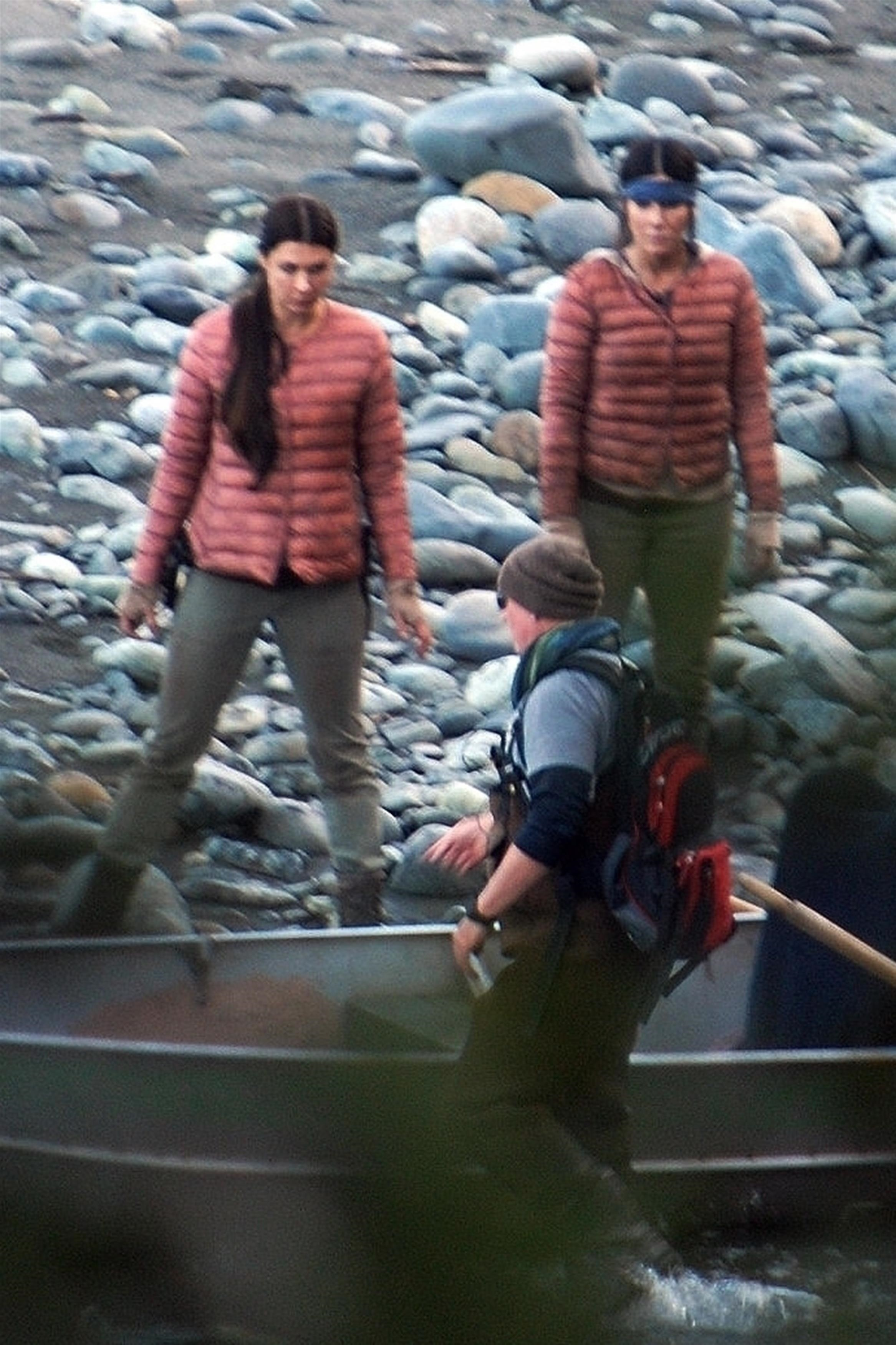 Sandra Bullock and her stunt double wearing red coats while filming