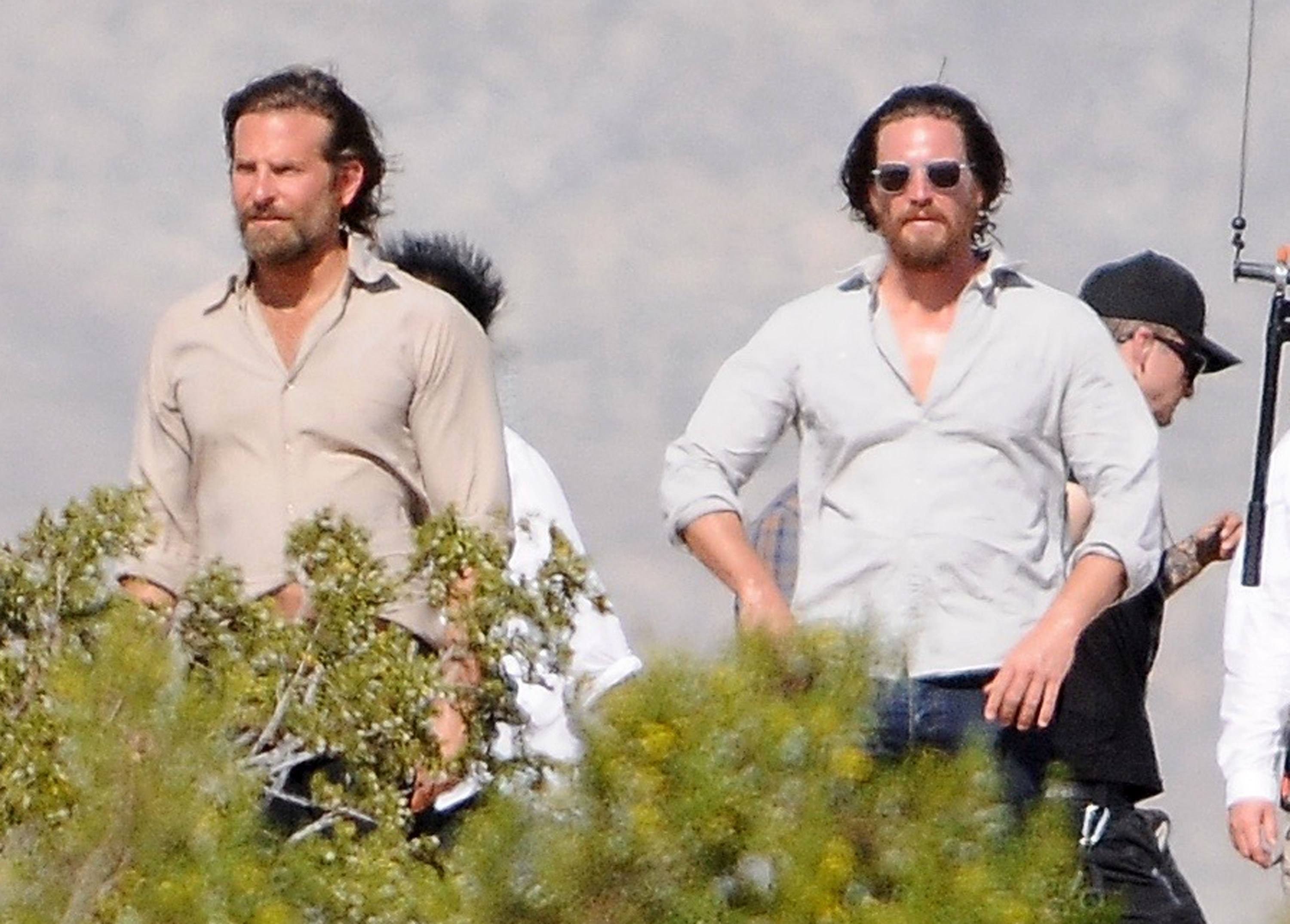 Bradley Cooper and his stunt double walking outside while filming