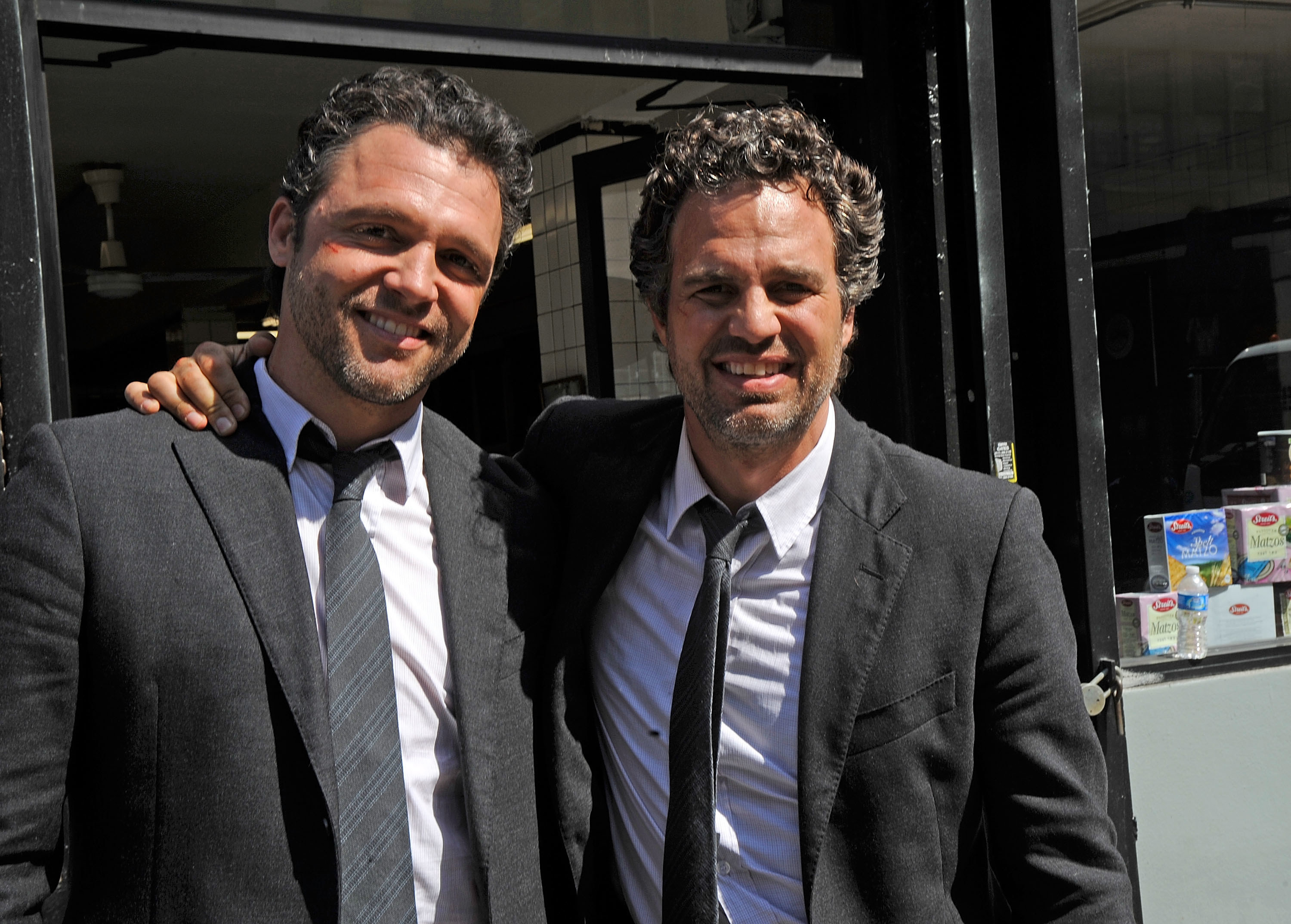 Mark Ruffalo and his stunt double smiling for a photo